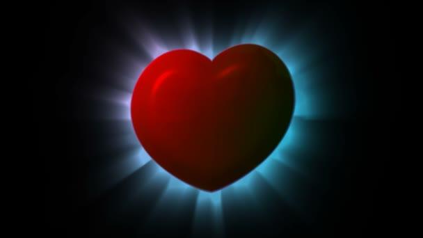 abstraktní motion grafika červené zářící srdce na tmavém pozadí