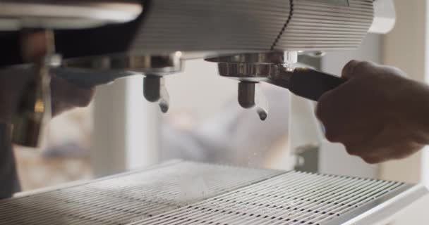 Coffee Pouring Into Cup From Professional Coffee Machine Shooting In 4k. Fresh Black Coffee Espresso Flows Into White Cup From Machine Dispenser. Making Coffee From Start To Finish In Coffeehouse