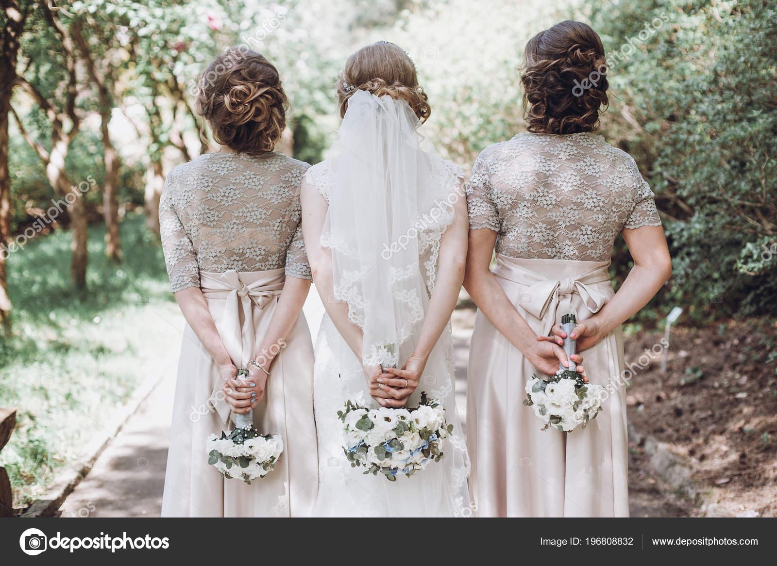Bride Bridesmaids Posing Holding Bouquets Back Happy Wedding Bride