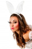 Lovely woman in rabbit costume on white background