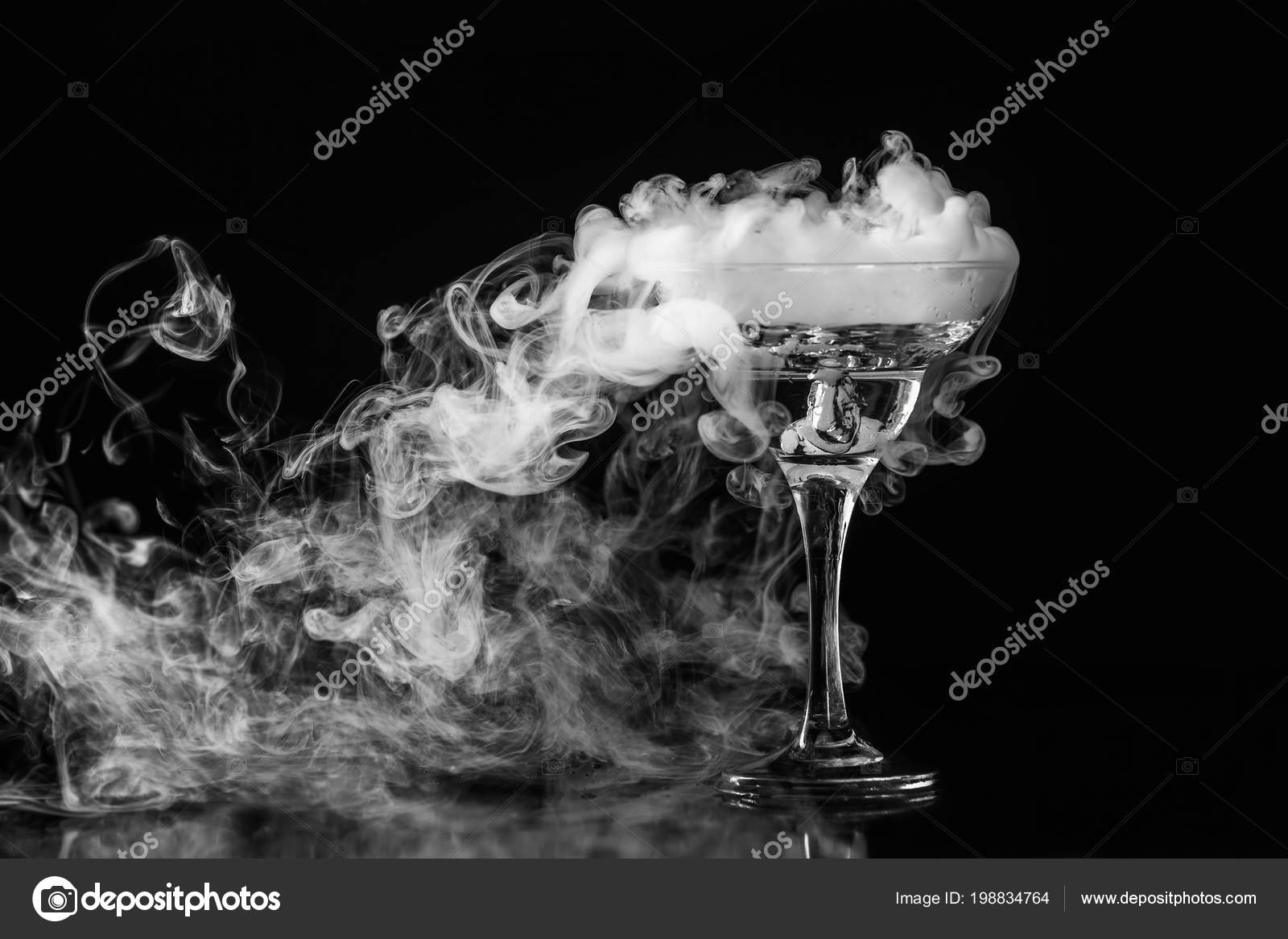Closeup glass white fog dark background chemical reaction dry ice stock photo