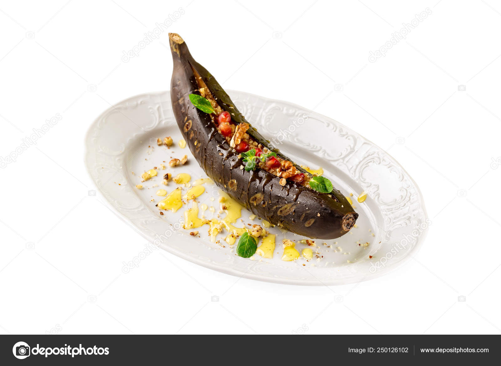 Grilled Banana Stuffed With Nuts Pomegranate And Honey On A