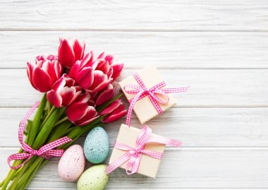 Gift boxes, easter eggs and tulips bouquet