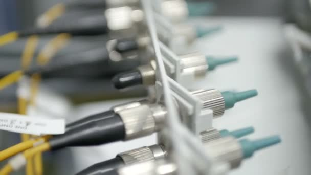 d425757c25a6 Technicians are installing optic fiber with cable ties.– stock footage