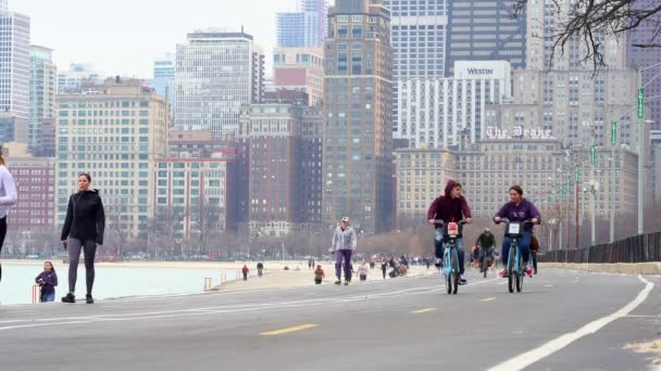 locals and tourists exercising along the lake shore