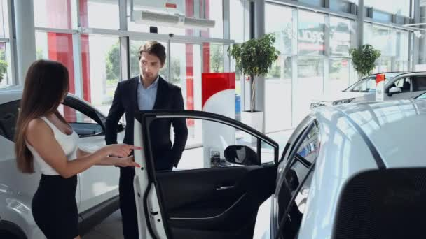 couple entering a car dealership to purchase a car