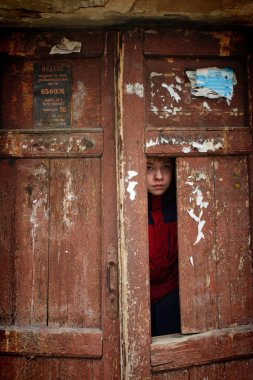 Barnaul,Russia-may 1, 2019.The child plays under the Windows of the emergency house