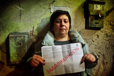 Barnaul,Russia-may 1, 2019.A woman holds a bill for an apartment with the inscription in Russian