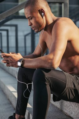 Man checking a playlist before training.