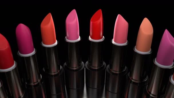 Rtěnky s červenou paletou se otáčejí na vitríně v obchodě s parfémy