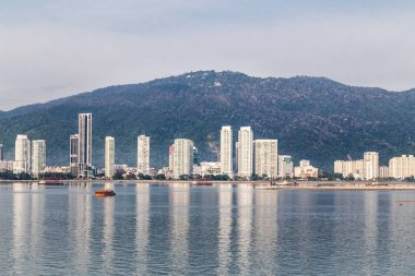 Sunrise cityscape view of Penang Island from Straits of Malacca, featuring profile of George Town