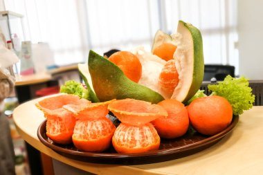 Prosperity good luck pomelo, oranges, salad received from Lion after dance performance