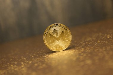 golden monero on golden background