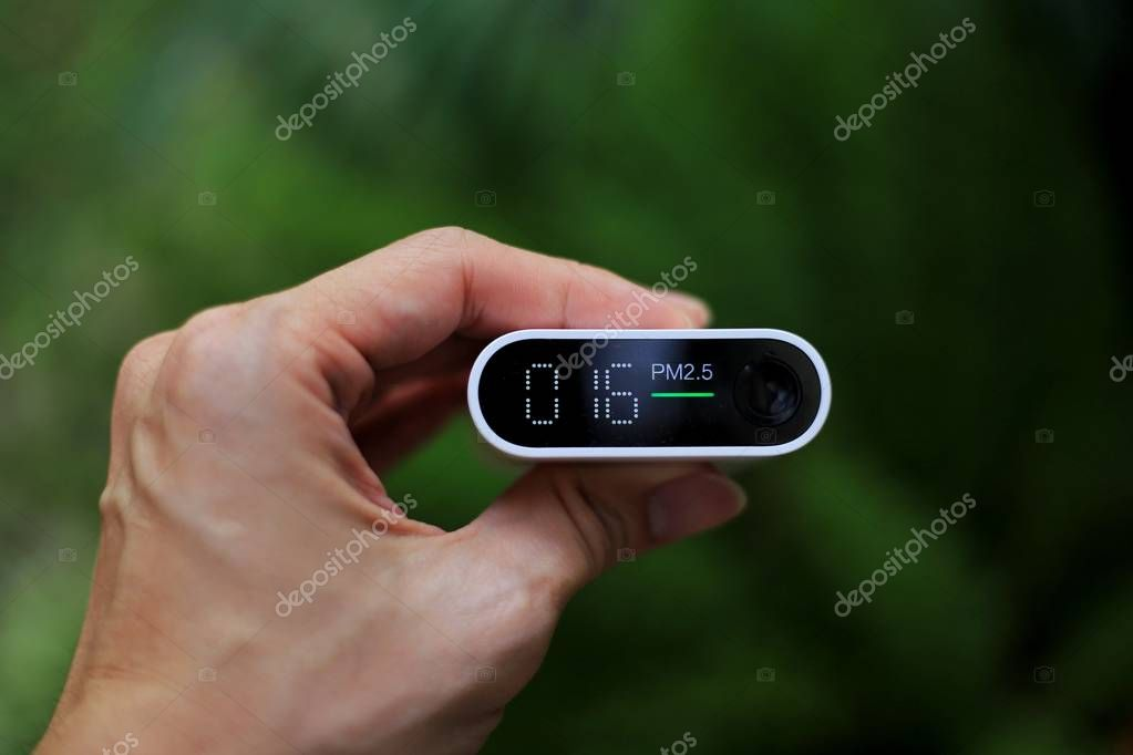 outdoor air quality measurement. pm2.5 (particulate matter) sensors detecting small dust in the atmosphere. good air with little dust in the air. park, garden and tree reduce air pollution.
