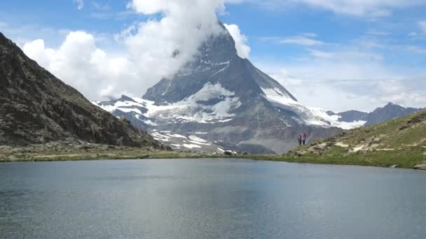 Scenic view of snowy Matterhorn peak and lake Stellisee, Swiss Alps, Switzerland