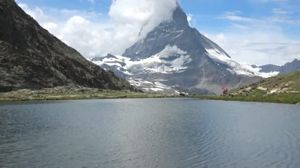 Scenic view of snowy Matterhorn peak and lake Stellisee, Swiss Alps, Switzerland