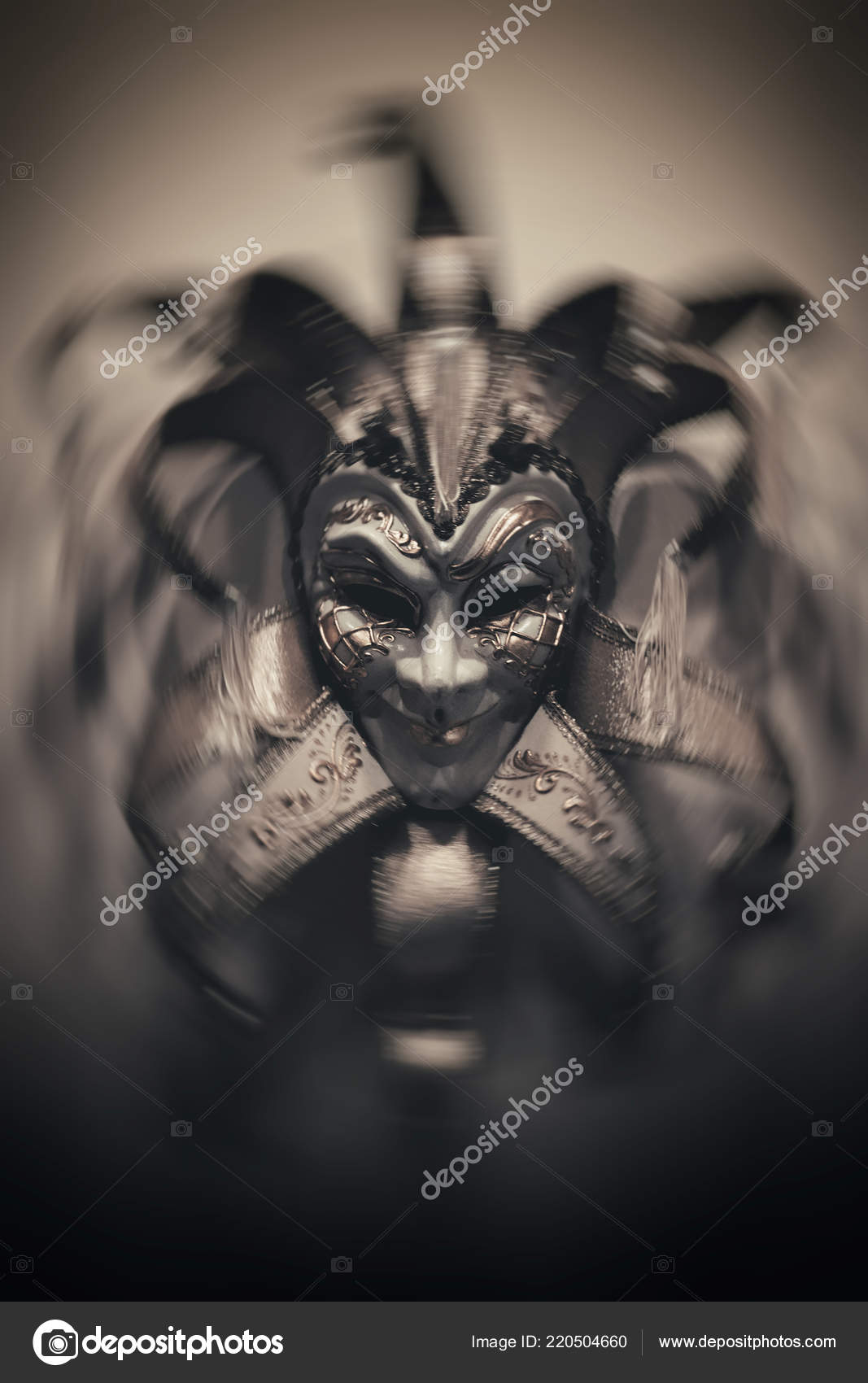Sinister joker mask dark background italy style mask stock photo