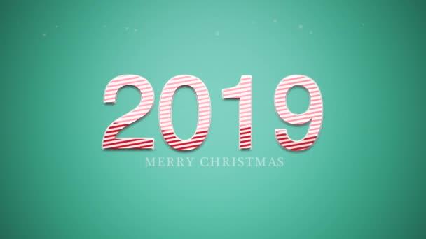 Animovaný closeup Merry Christmas text a čísla 2019 na zeleném pozadí. Luxusní a elegantní dynamický styl šablony pro zimní dovolenou