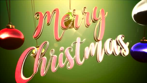 Animovaný closeup veselé vánoční text, barevné koule na zeleném pozadí. Luxusní a elegantní dynamický styl šablony pro zimní dovolenou