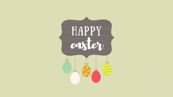 Animated closeup Happy Easter text and eggs on green background