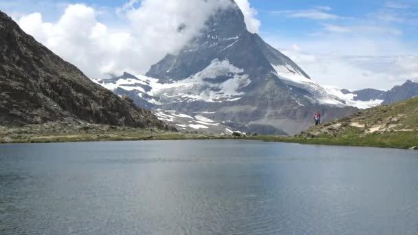 Scenic view on snowy Matterhorn peak and lake Stellisee, Swiss Alps, Zermatt, Switzerland