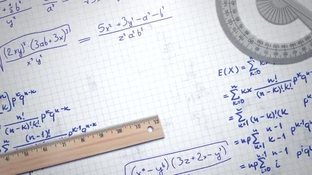 Closeup mathematical formula and elements on paper, school background