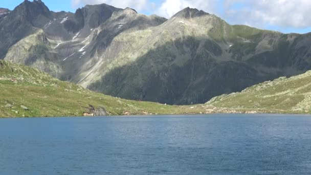Scenic view of peak of mountains and lake in Swiss Alps