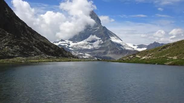 Timelapse view on Matterhorn peak and lake Stellisee, Swiss Alps, Zermatt, Switzerland