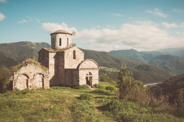 Old church in mountains, in national park Dombai, Caucasus, Russ