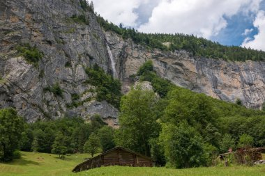 View valley of waterfalls in national park of city Lauterbrunnen