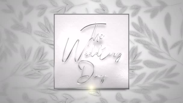Closeup text The Wedding Day and vintage frame with flowers motion, wedding background