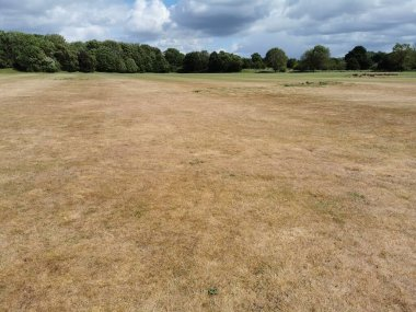 Parched field and dead grass due to heatwave in the UK in May 2020