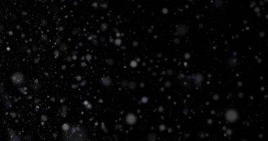 Siyah bir zemin üzerine kar yağışı