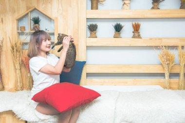 asian beautiful caucasian woman holding cat with love