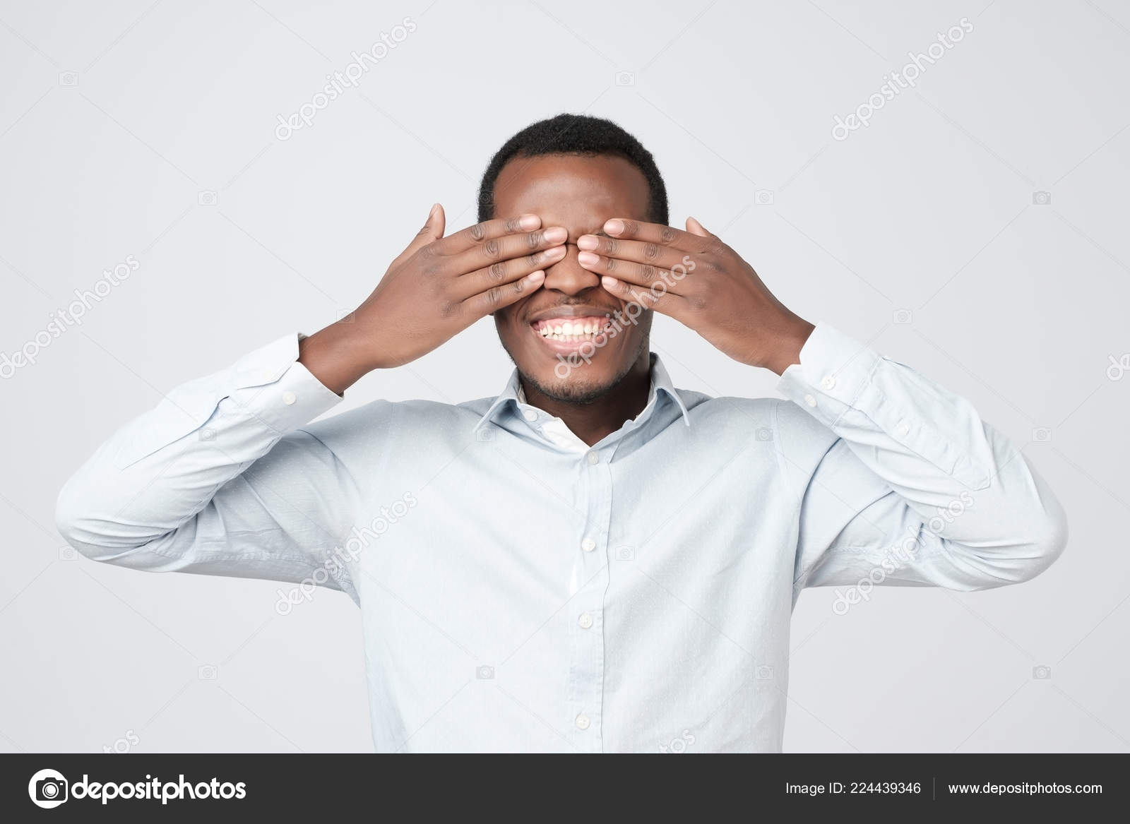 Young Happy African Man Covering Eyes Hands Waiting Birthday Gift Stock Photo