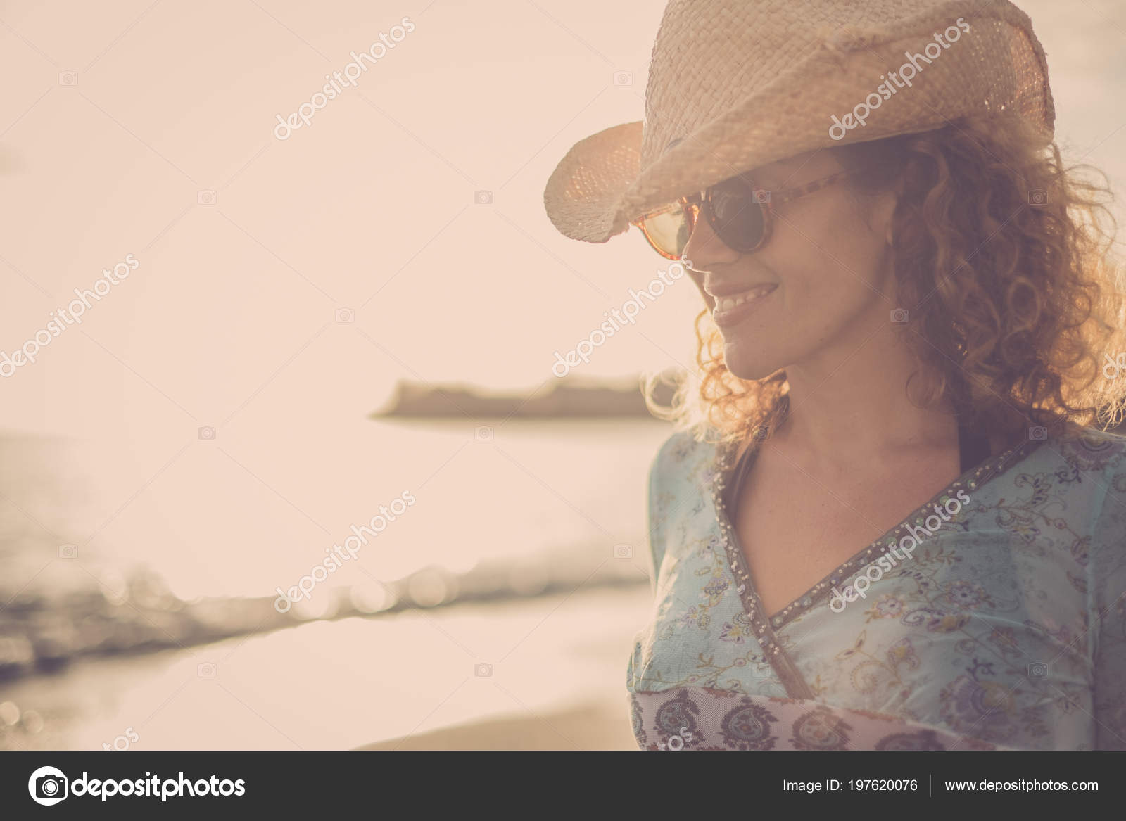 8e70f245e6ade Beautiful and wonderful blonde curly hair model middle age with cowboy hat  smile and pose at the beach with golden sunset in the background. colored  and ...