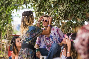 hippy party and friendship for young free and happy colored women having fun and staying together with love and relationship. fashion clothes and dresses for females in outdoor activity celebrating