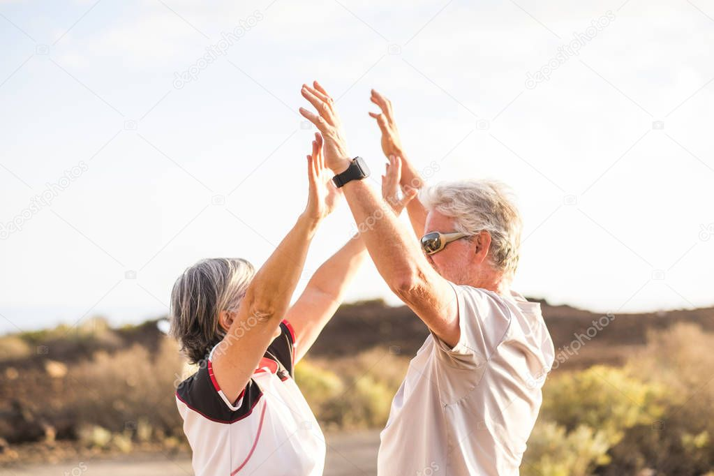couple enjoy and giving five outdoors