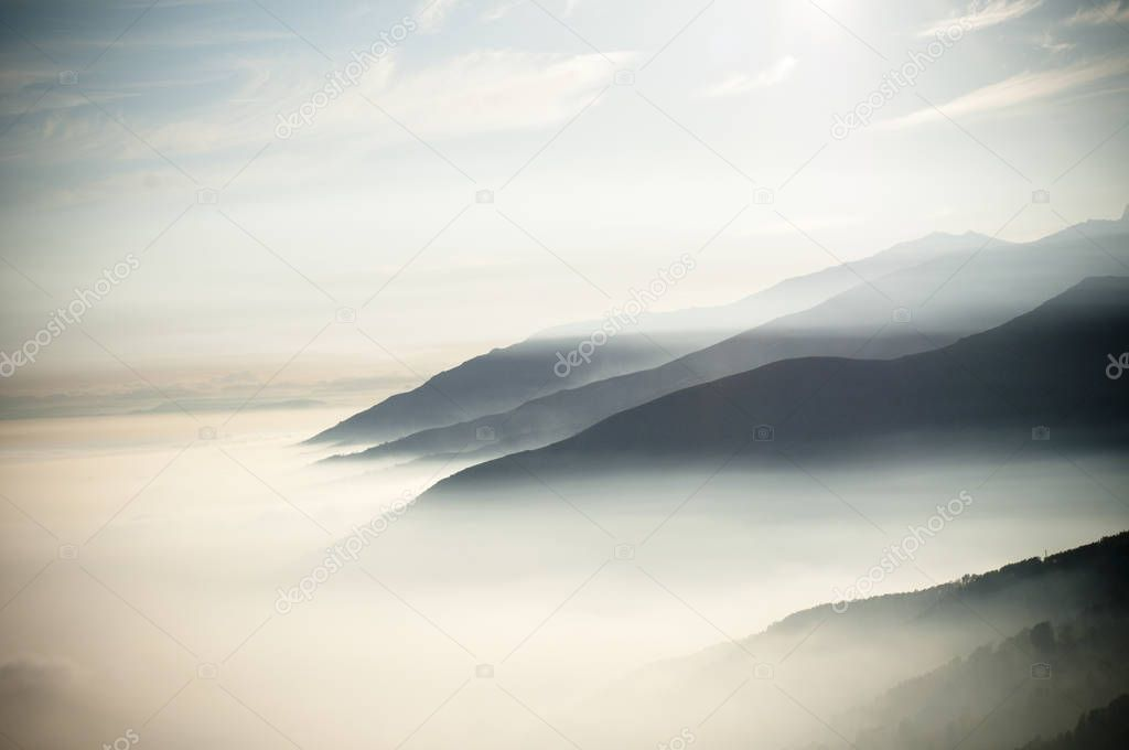 top of mountains with clouds like fog at early morning