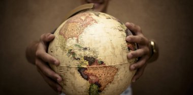hands holding globe sphere, travel concept