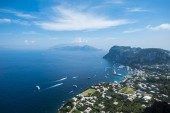 Fotografie sea view from cruise boat of Naples with Vesuvius vulcan and campania cliff of Italy