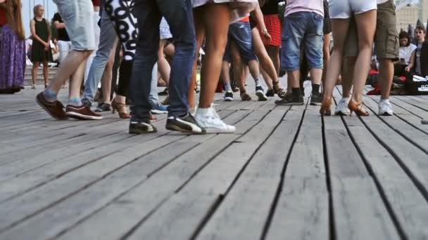 Moscow ,Russia - June 23 ,2018. Men and women dancing on wooden floor in the park in summer evening