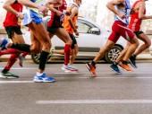 Rome, Italy - April 8, 2018: runners men run city road in Rome Marathon and Run for Fun