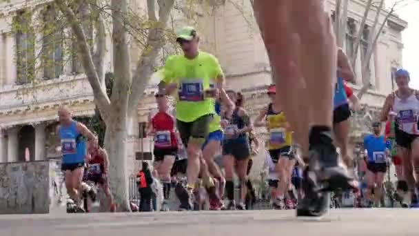 Rome, Italy - April 8, 2018: large group men and women runners run of race during Rome marathon