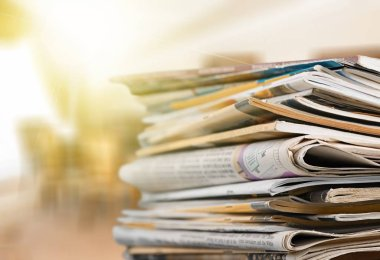 Pile of newspapers on background, close-up view
