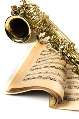 Saxophone On Music Notes Book Close-up