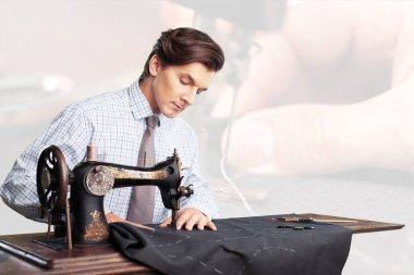 Tailor at work. Confident young tailor sewing clothes at the tailor shop