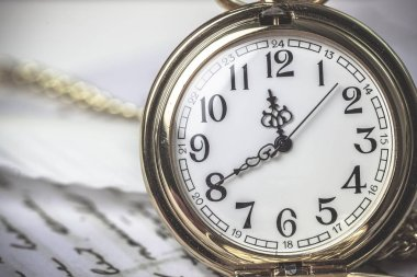 Old stopwatch on a white