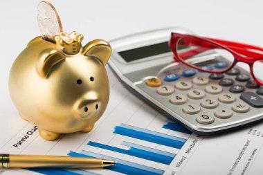Calculator piggy bank coin bank penny bank business charts bar chart data analysis