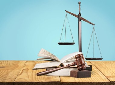 Justice Scales, gavel and books on background